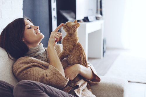 A woman with a cat.